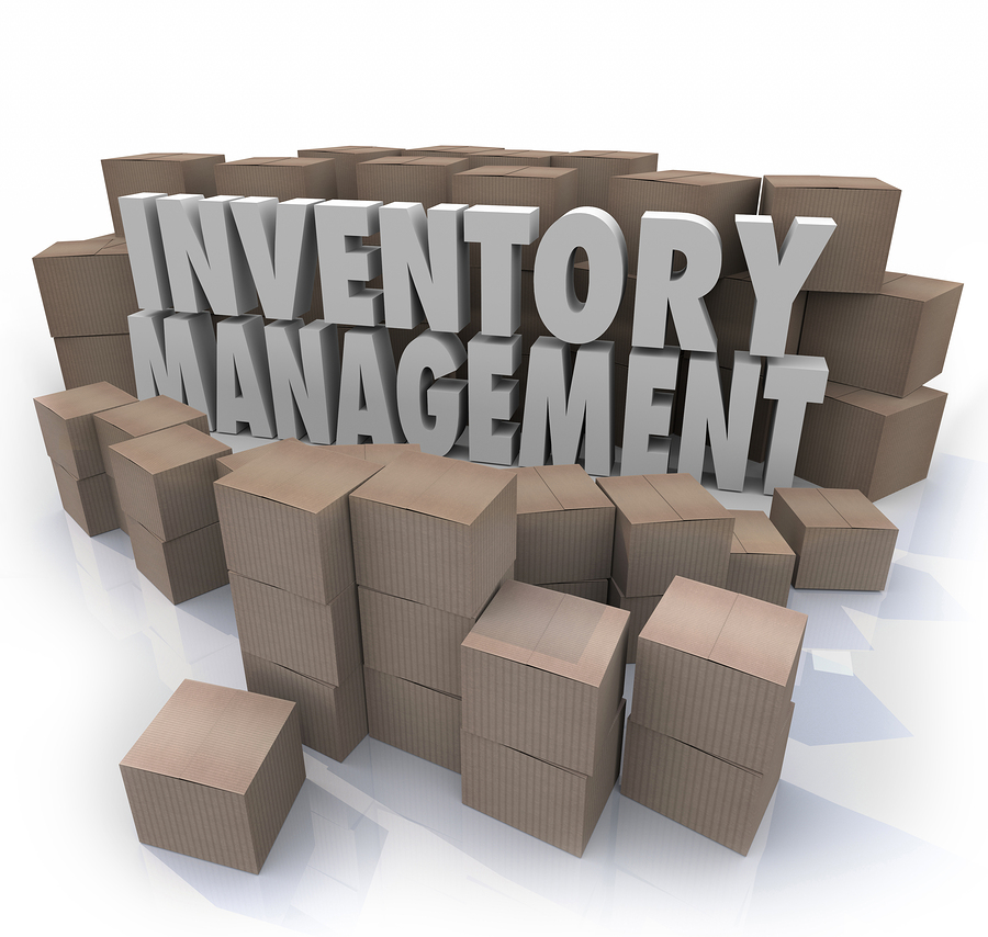 Inventory management words in 3d letters surrounded by cardboard